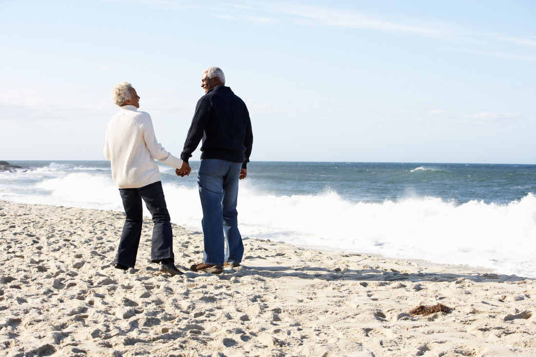 Picture of  Happy Older Couple Holding Hands on the Beach