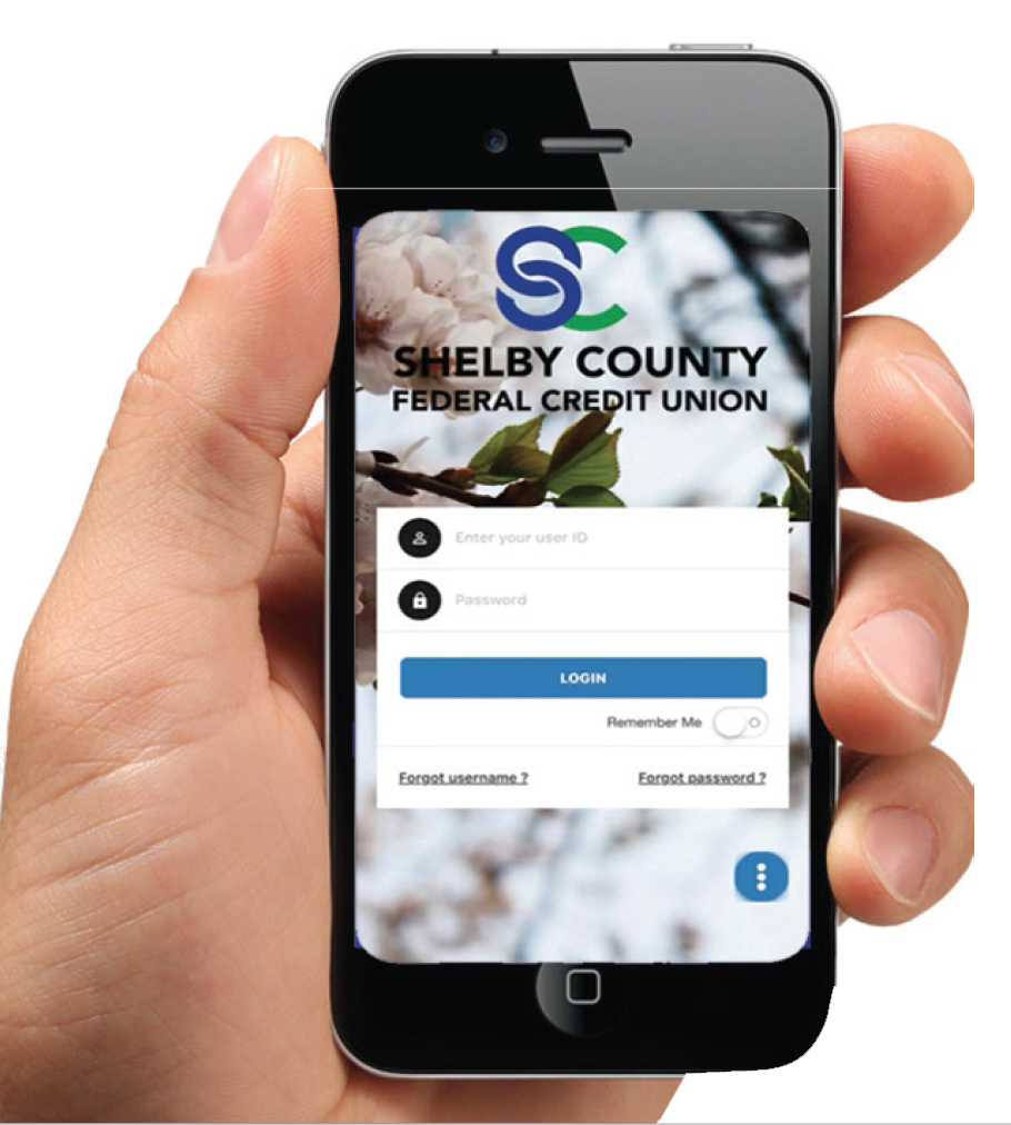 Picture of hand hplding mobile phone with Shelby County Federal Credit Union Mobile App on screen