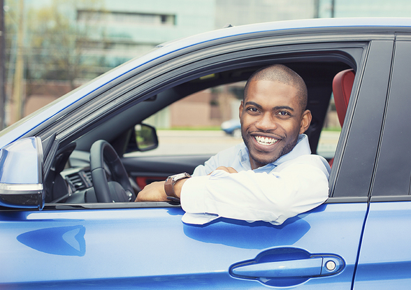 Picture of Young Guy Hanging Elbow Out of Car Window and Smiling Big